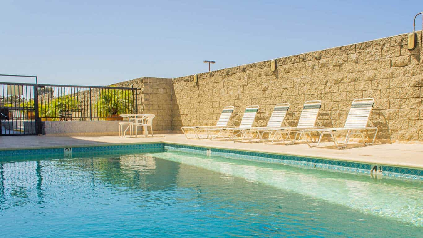 Enjoy Southern California Weather - Our pool has beach chairs for you to relax.